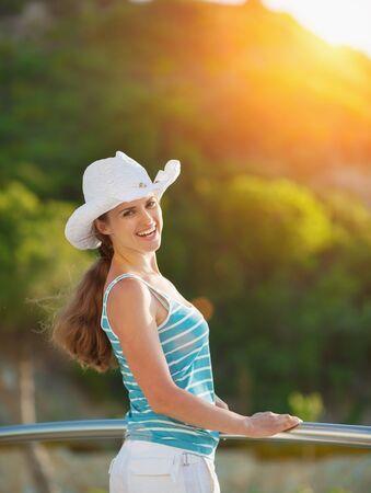 idealistic: Portrait of happy woman enjoying vacation