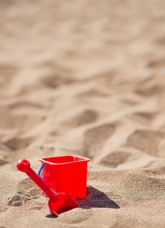 Baby bucket and shovel on the sandy beach Stock Photo - 14341328