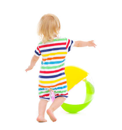 Baby in swimsuit playing with ball. Rear view Stock Photo - 14433319