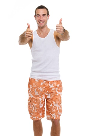 Smiling resting on vacation young man in shorts and t-shirt showing thumbs up