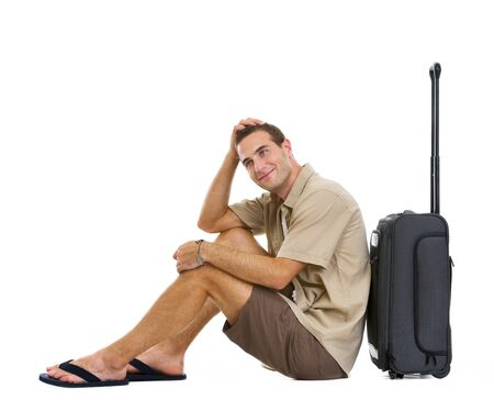 stargaze: Happy tourist sitting near wheels bag and dreaming about vacation