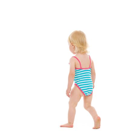 Baby in swimsuit walking away  Rear view Stock Photo - 14529578