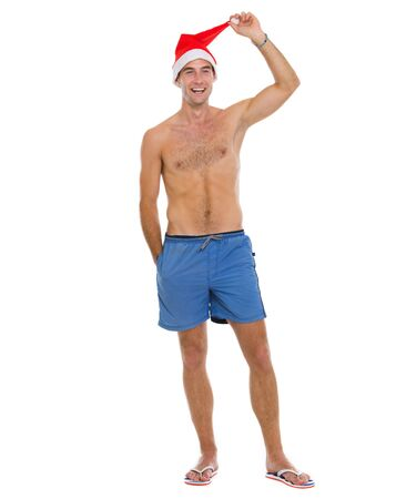 Full length portrait of on vacation man in shorts and Santa Stock Photo - 14529586