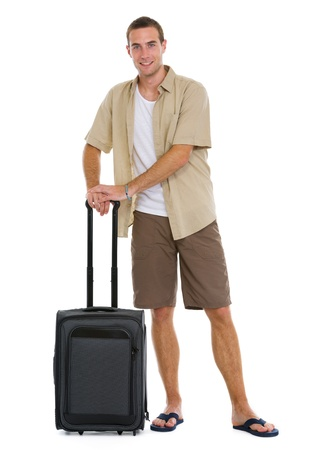 Happy tourist with wheels bag ready to vacation Stock Photo - 14529604
