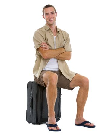 Happy tourist sitting on wheels bag Stock Photo - 14529622