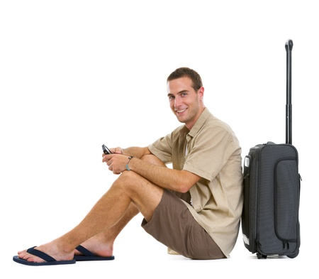 Happy tourist sitting near wheels bag Stock Photo - 14529600