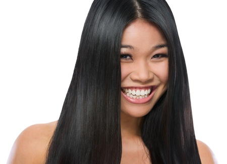 Beauty portrait of smiling asian girl smooth long straight hair isolated on white