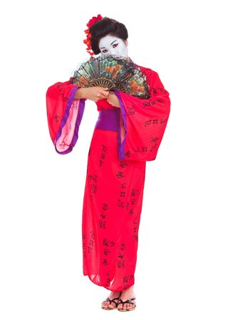 Full length portrait of geisha hiding behind fans isolated on white photo