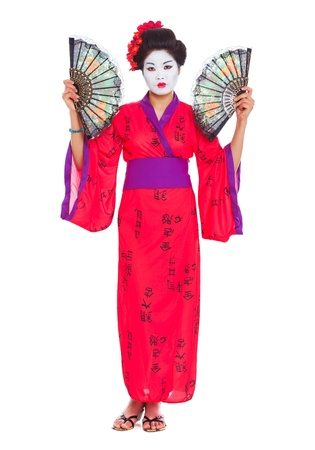Full length portrait of geisha with fans isolated on white photo
