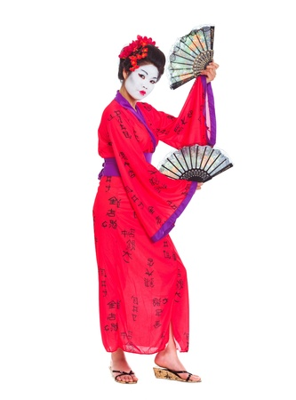 Full length portrait of geisha dancing with fans isolated on white photo