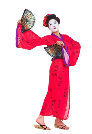 Full length portrait of geisha dancing with fans isolated on white
