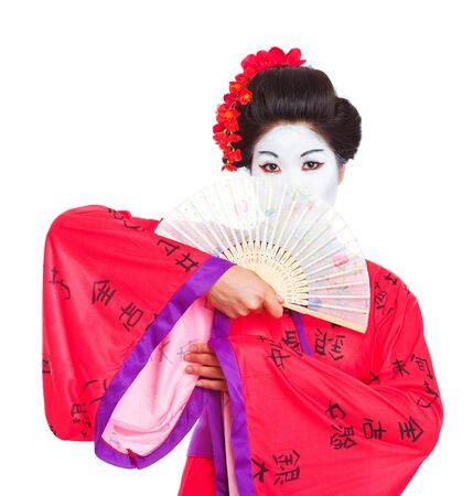 Portrait of geisha hiding behind fan isolated on white photo