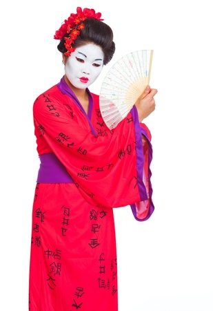 Portrait of geisha with fan isolated on white photo