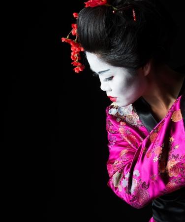 Closeup portrait of geisha isolated on black Stock Photo