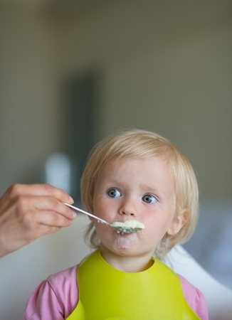 Eat smeared baby feeding by mother Stock Photo - 14634436