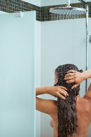 Woman with long hair taking shower. Rear view Stock Photo - 14634467