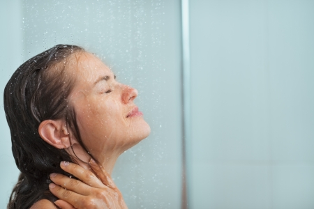 douche: Portrait of woman taking shower Stock Photo