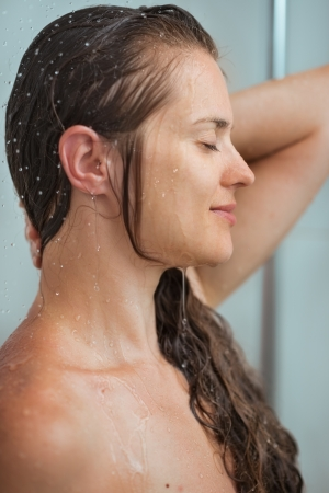 Portrait of relaxed woman with long hair in shower photo