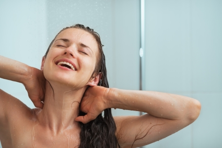 Portrait of relaxed woman taking shower photo
