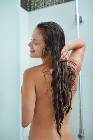Happy woman bathing in shower under water jet Stock Photo - 14634447
