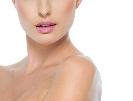 Closeup on female neck and lips isolated on white Stock Photo - 14634450