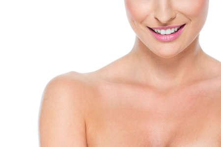 Closeup on smiling female lips isolated on white Stock Photo - 14634469