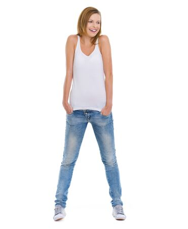 Full length portrait of smiling teenage girl looking on copy space photo