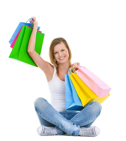 Full length portrait of happy teenage girl sitting with shopping bags Stock Photo - 14634424