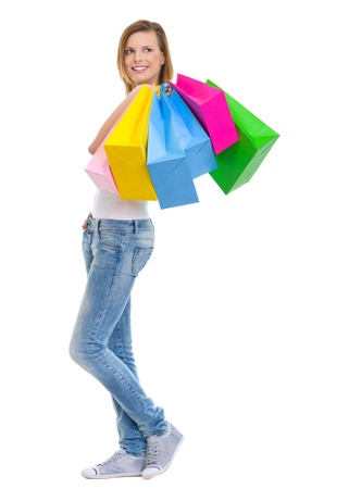 Smiling teenage girl with shopping bags looking on copy space Stock Photo - 14634423