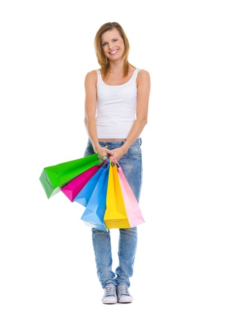 Full length portrait of smiling teenage girl with shopping bags photo