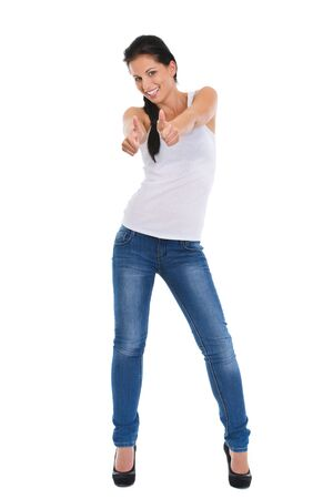 Full length portrait of smiling girl showing thumbs up Stock Photo - 14634484