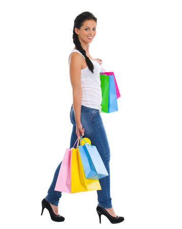 Full length portrait of smiling girl with shopping bags Stock Photo - 14634482