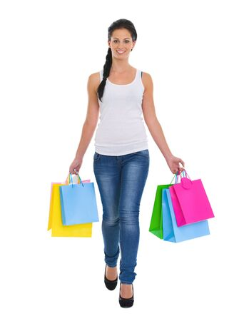 Smiling girl walking with shopping bags Stock Photo - 14634485