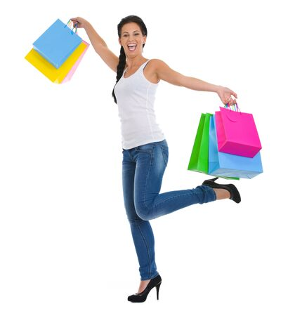 Full length portrait of cheerful girl with shopping bags Stock Photo - 14634481