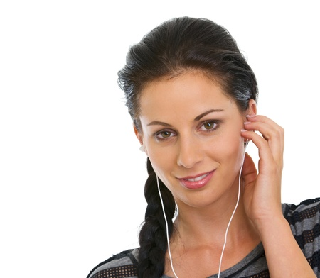 Portrait of happy girl listening music in headphones Stock Photo - 14634498