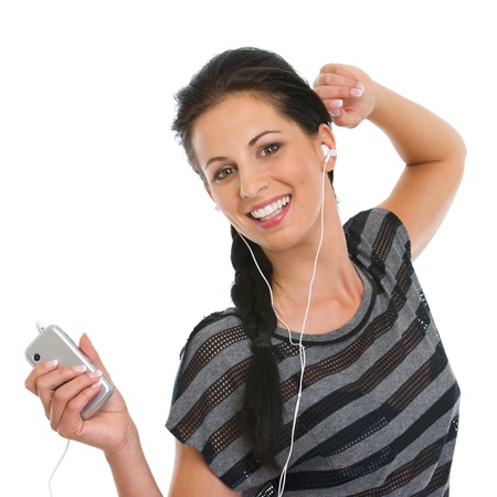 Portrait of happy girl listening music in headphones and dancing Stock Photo - 14634499