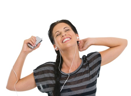 Portrait of girl relaxing by listening music in headphones Stock Photo - 14634496