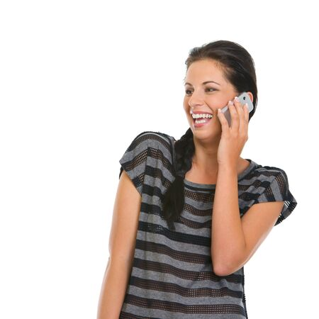 Happy girl speaking mobile phone and looking on copy space Stock Photo - 14634490