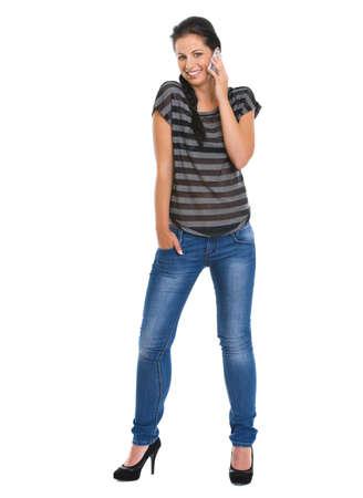 Full length portrait of smiling girl speaking mobile phone Stock Photo - 14634489