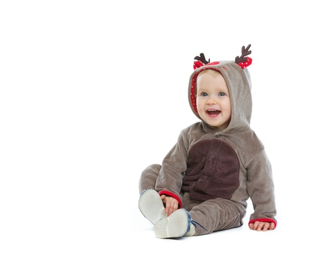 baby christmas: Smiling baby in Christmas costume looking on copy space