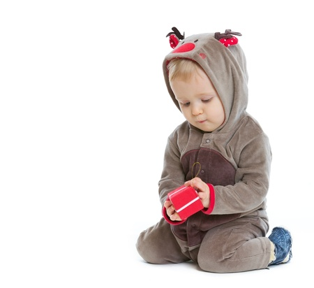 Baby checking little Christmas present box Stock Photo - 14768015