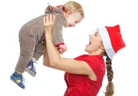 Mother in Santa's hat playing with baby Stock Photo - 14768027