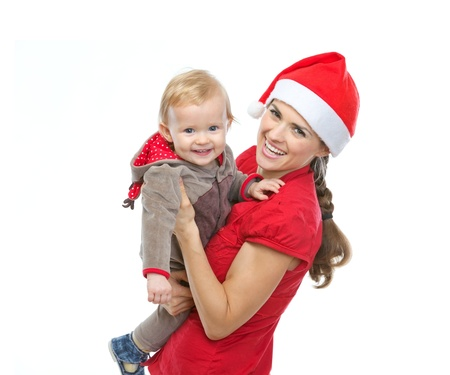 Portrait of mother in Santa's hat playing with baby Stock Photo - 14768017
