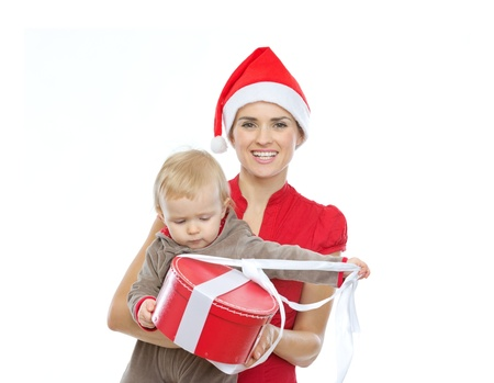 Mother in Santa's hat holding baby opening Christmas present Stock Photo - 14768011