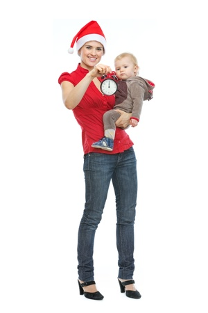 Mother in Santa's hat holding baby and alarm clock Stock Photo - 14768013