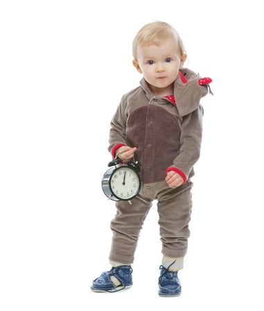 Baby in Santa's deer costume holding alarm clock Stock Photo - 14768005