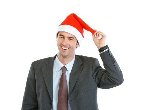 Portrait of smiling businessman playing with Santa's hat Stock Photo - 14768050