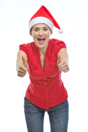 Smiling young woman in Christmas hat showing thumbs up Stock Photo - 14768179
