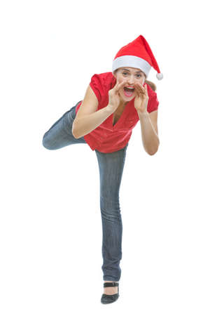 shaped hands: Cheerful woman in Christmas hat shouting through megaphone shaped hands