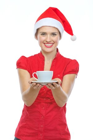 Happy woman in Christmas hat holding cup of hot beverage photo
